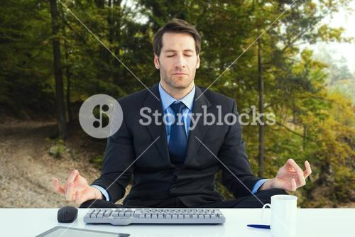 Composite image of calm businessman sitting in lotus pose