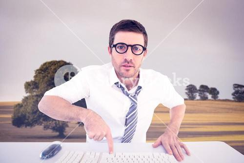 Composite image of businessman working at his desk
