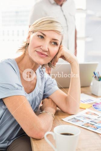 A thoughtful businesswoman looking away