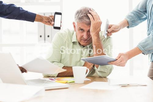 Overwrought businessman with hands on head