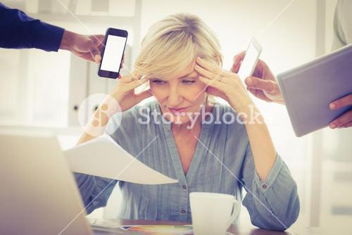 Overwrought businesswoman with hands on head