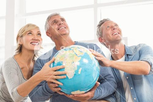 Happy business colleagues holding terrestrial globe