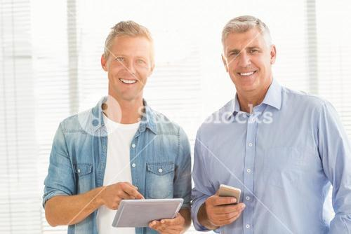 Business colleagues working on tablet and phone