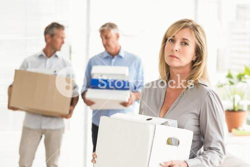Disappointed casual businesswoman with carton