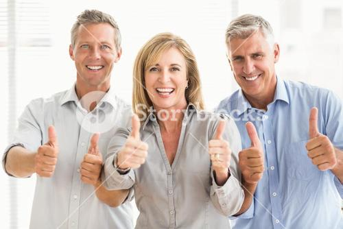 Smiling casual business people doing thumbs up