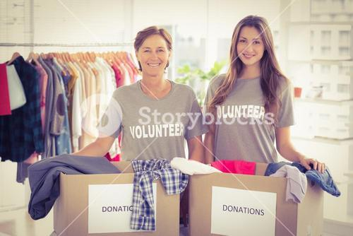 Concerned businesswomen with donation boxes