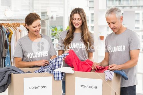 Concerned business people with donation boxes