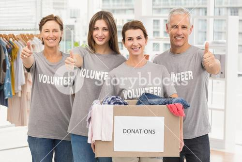 Smiling volunteers with donation box