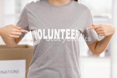 Female volunteer showing her shirt