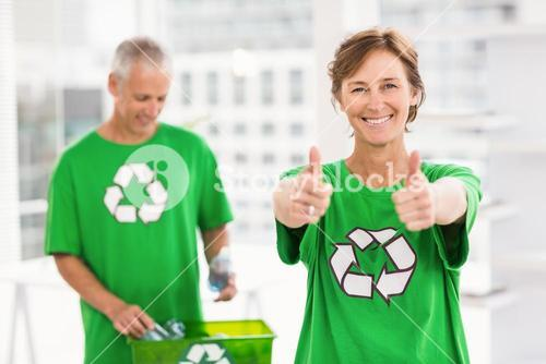 Smiling eco-minded woman doing thumbs up