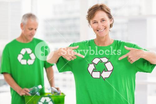 Smiling eco-minded woman showing her recycling shirt