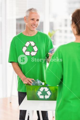 Smiling eco-minded man with recycling box