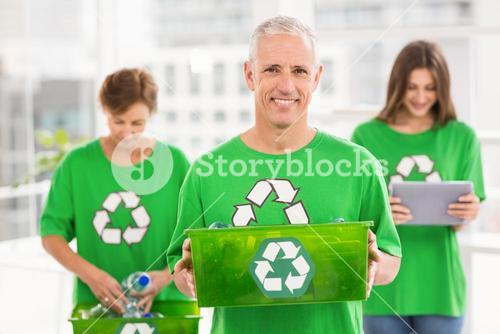 Smiling eco-minded man holding recycling box