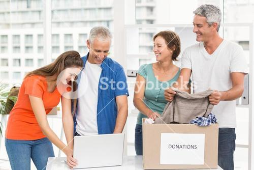 Casual business people sorting donations