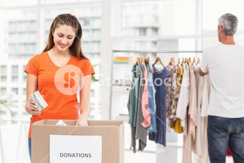 Casual business colleagues sorting donations