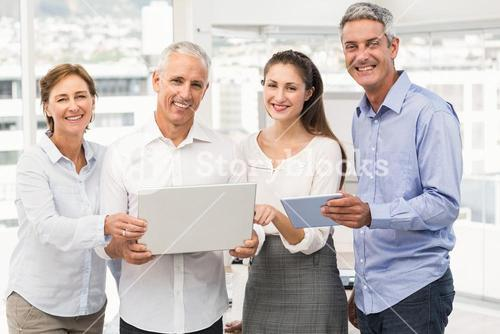 Smiling business people with laptop