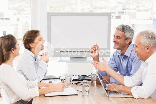 Laughing business people having a meeting