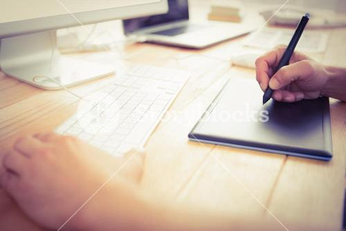 Graphic designer working with digitizer