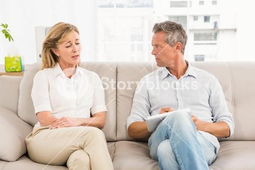 Concerned therapist listening to female patient