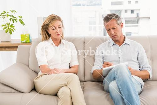 Concerned therapist talking with female patient
