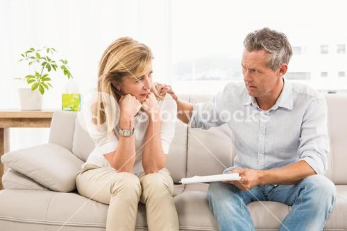 Concerned therapist comforting female patient