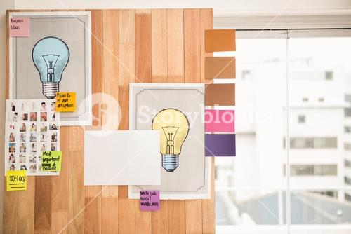 Illustrations and sticky notes on wooden wall