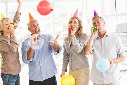 Casual business people celebrating birthday