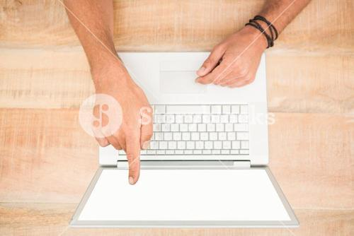Hand pointing on blank laptop screen