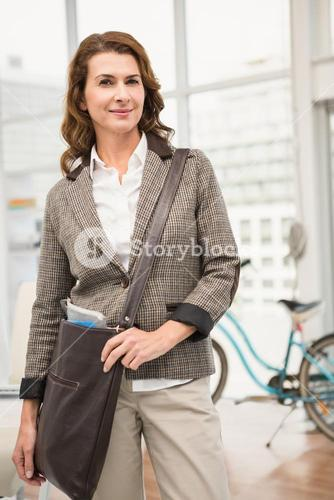 Smiling casual businesswoman posing