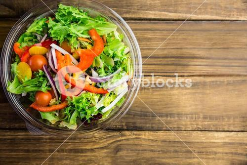 Healthy bowl of salad on table