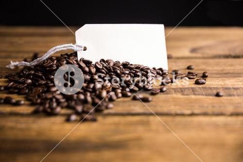 Coffee beans on a table with tag