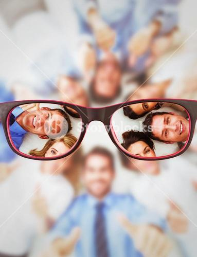 Composite image of business people gesturing thumbs up