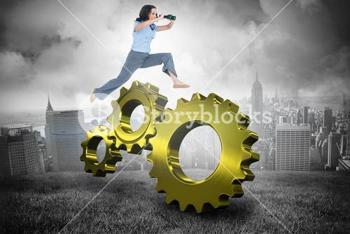 Composite image of cheerful classy businesswoman jumping while holding binoculars