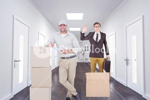 Composite image of delivery man with clipboard leaning on cardboard boxes