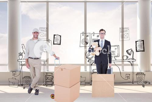 Composite image of confident delivery man with cardboard boxes
