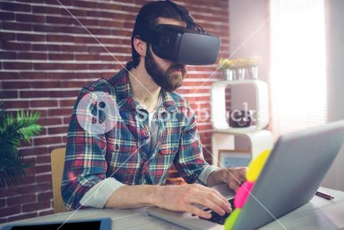 Creative businessman wearing 3D video glasses at office