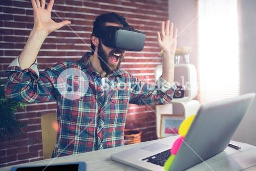 Surprised creative businessman wearing 3D video glasses