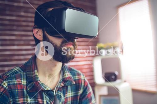Smart creative businessman wearing 3D video glasses
