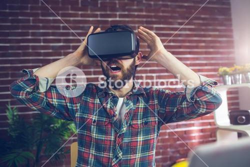 Shocked editor wearing 3D video glasses