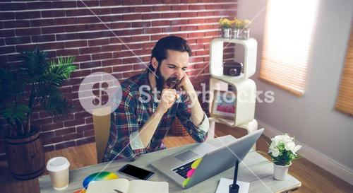 High angle view of businessman yawning at office