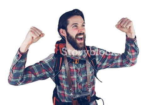Excited hiker with arms raised