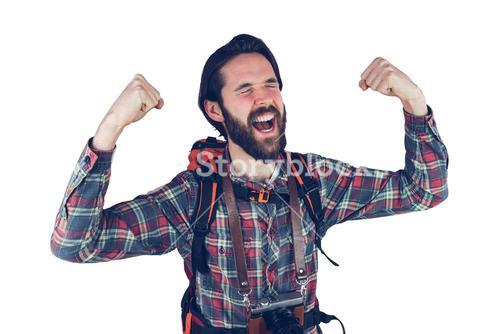 Excited adventurer with arms raised