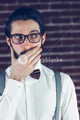 Nervous man covering mouth