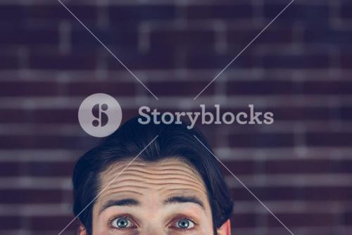 Portrait of man with raised eyebrows