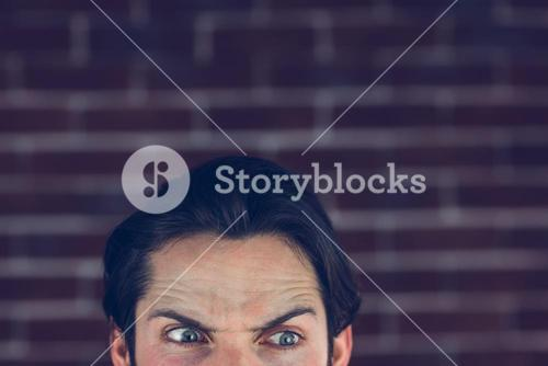 Angry man with raised eyebrows looking away