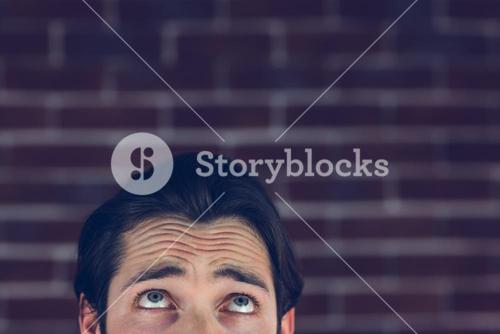 Confused man with raised eyebrows