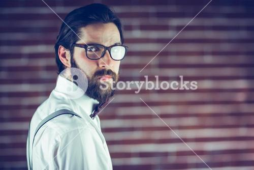 Portrait of confident hipster wearing eyeglasses