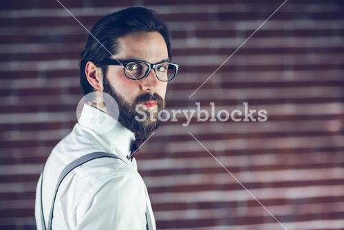 Portrait of serious hipster wearing eyeglasses