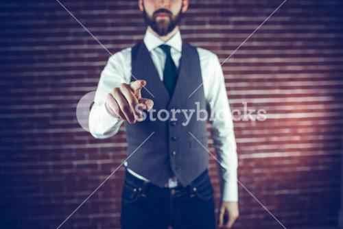 Midsection of hipster pointing finger