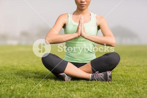 Peaceful sporty woman doing yoga